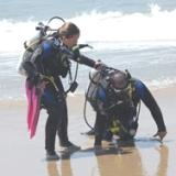 Beach rescue with scuba gear on